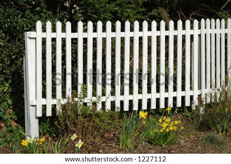 White picket fence and flower bed.