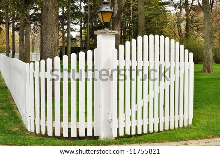 White picket fence with a gate - stock photo