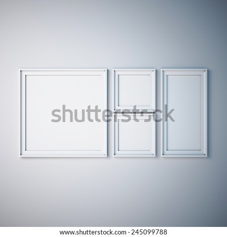 white picture frame on white wall - stock photo