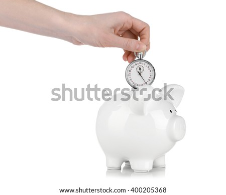 White piggy bank and a hand holding timer above it isolated on white - stock photo