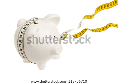 White piggy bank with measuring tape on white background - stock photo