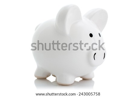 White piggy bank with reflection on white background - stock photo