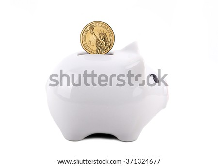 White piggy bank with US dollar coin in the slot. Concept of saving for a rainy day, education, retirement, etc. Isolated on White.