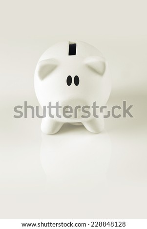 White Piggy coin bank for money savings, financial security or personal funds concept. - stock photo