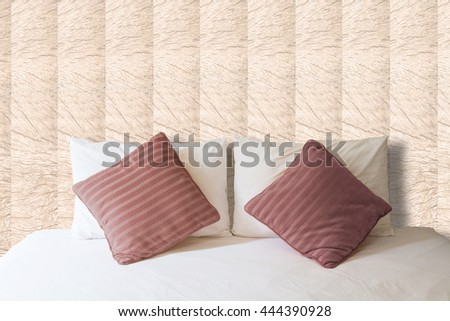 white pillow and brown pillow on bed and with blanket in vintage bedroom