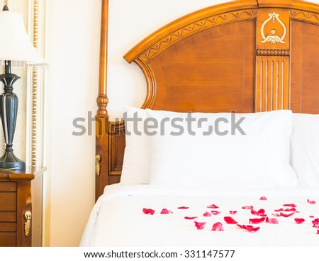 White Pillow on bed and light lamp decoration in hotel bedroom interior