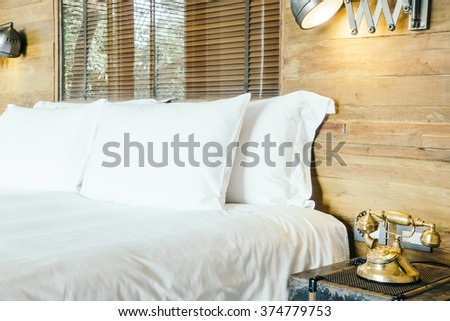 White pillow on bed decoration in bedroom interior - Vintage Light Filter and Selective focus point