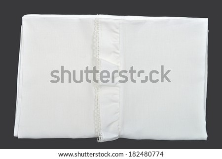 White pillowcase with lace on black background