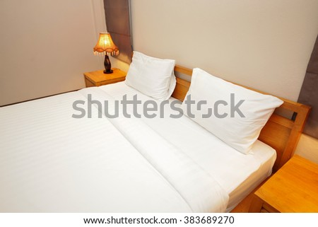 White pillows on a bed Comfortable soft pillows on the bed room. - stock photo