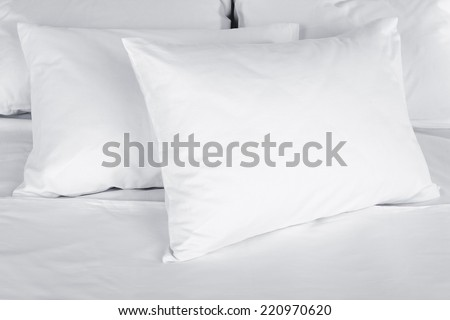 White pillows on bed close up - stock photo