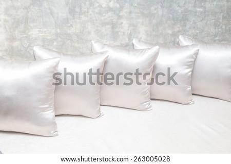 White pillows on sofa close up - stock photo