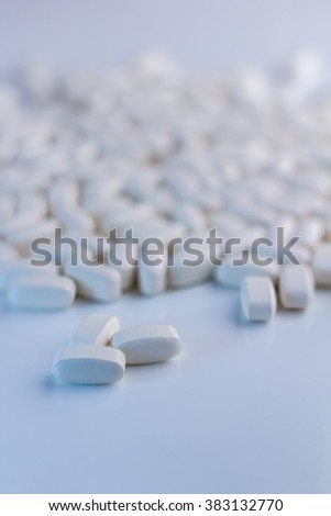 White pills background selective focus