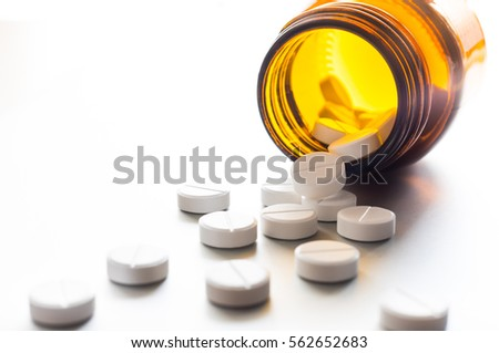White pills in a bottle