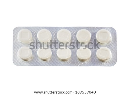 White pills in transparent blister packs isolated on white background with work path