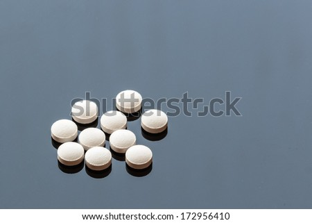 White Pills isolated on  Glass Background, Copy space - stock photo
