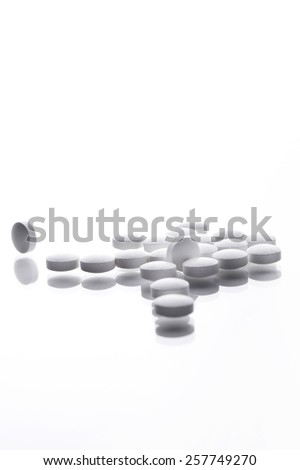 White pills isolated over white background. - stock photo