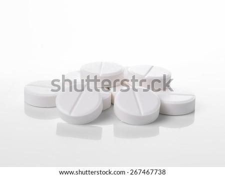 white pills on white background - stock photo