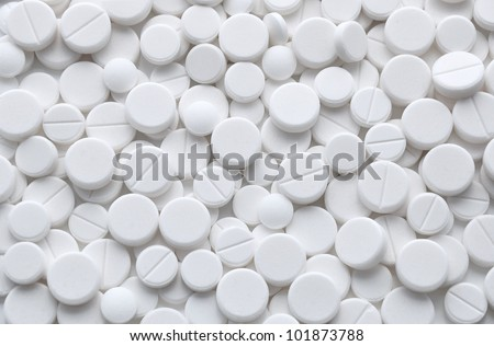 White pills (tablets) background. Medicine objects. - stock photo