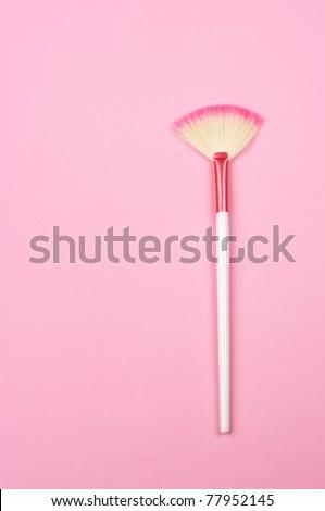 White-pink make-up brush on pink background. - stock photo