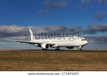 White plane after landing at the airport on a blue sky with beautiful clouds