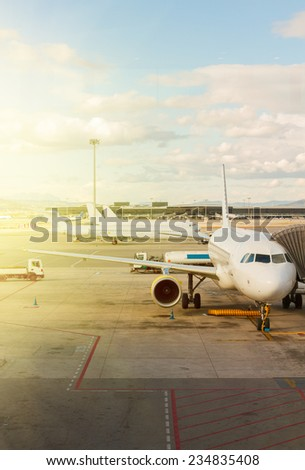 white plane at airport waiting for departure - stock photo