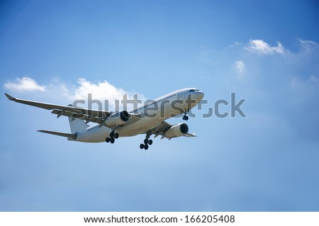 white plane in the blue sky - stock photo