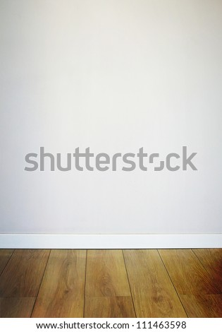 White plaster wall and wooden floor interior - stock photo