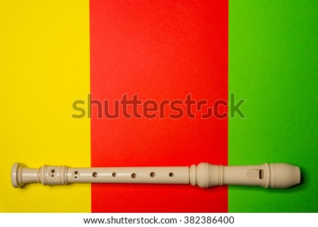 White plastic flute isolated on colored background - stock photo
