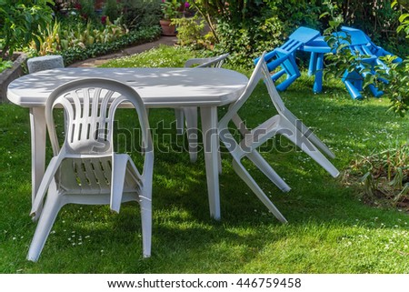 White plastic furniture garden chair table children kids lawn trees. Plastic Garden Furniture Stock Images  Royalty Free Images