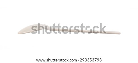 White plastic spoon isolated on white background