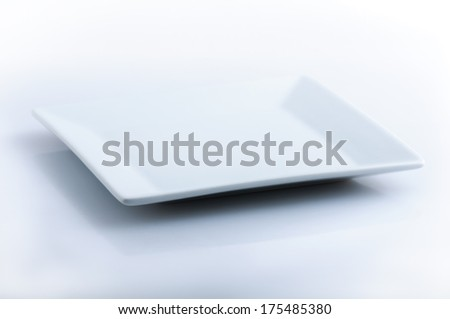 White plate on white background - stock photo