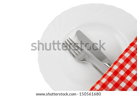 White plate, tablecloth, knife and fork isolated on white
