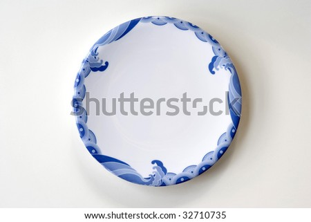 White Plate with Blue Trim - stock photo