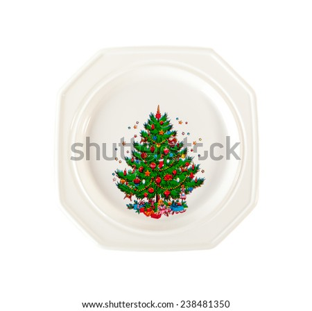 White plate with Christmas tree ornament isolated on white  background - stock photo