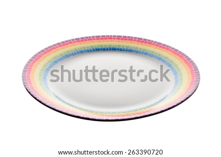 White plate with rainbow colored border isolated on white background. Angle view, deep depth of field, picture is in focus from front to back. - stock photo