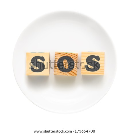 White plate with sign SOS composed of wooden blocks. Bad food concept - isolated on a white background.