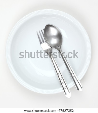 White plate with spoon and folk, isolate on white background.