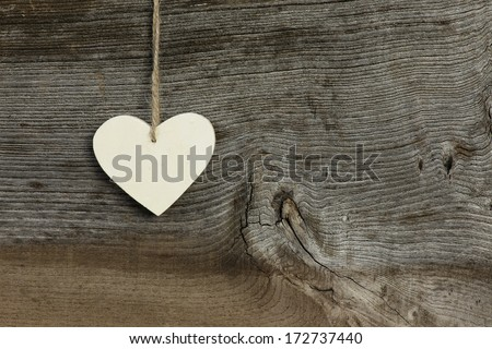 White plywood   Valentine's heart hanging on rustic Elm wooden texture background, copy space - stock photo
