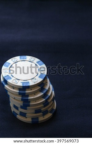 White poker chips on a dark background