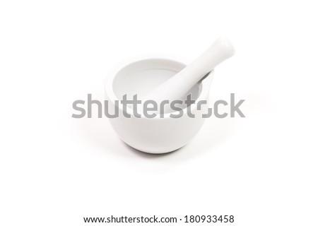 white porcelain mortar and pestle set on white - stock photo