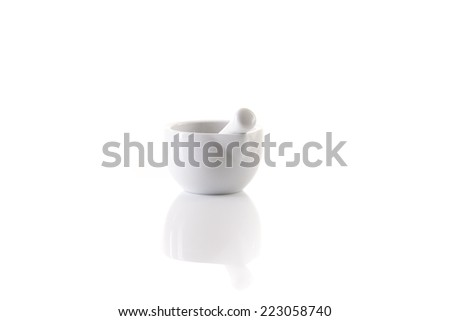 white porcelain mortar and pestle set on white with reflection - stock photo