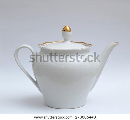 white porcelain teapot tea - stock photo