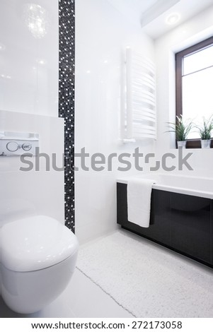 White porcelain toilet in new small clean bathroom - stock photo