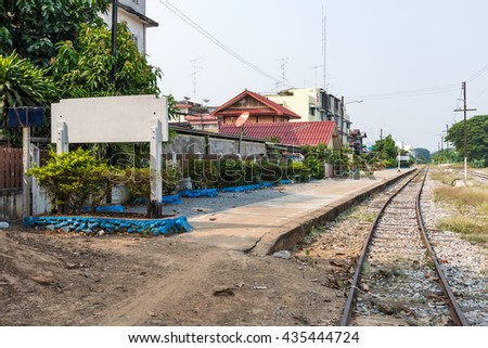 White post of the local train station in the small city, northern of Thailand. - stock photo