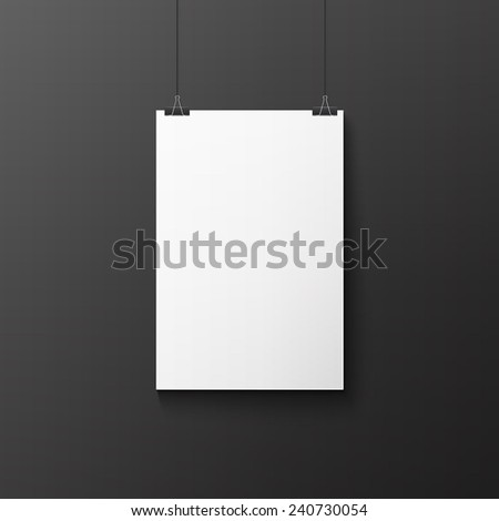 white poster on a rope on black wall - stock photo
