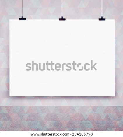 white poster on a wall - stock photo