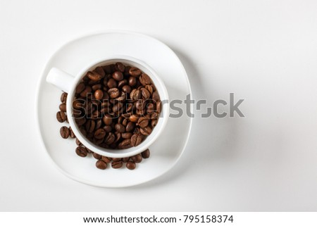 White pot with coffee on a white background with a blank space