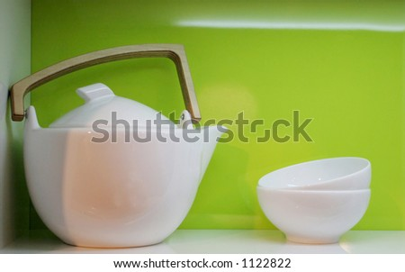 White pottery in a green kitchen
