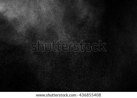 White powder explosion on black background.