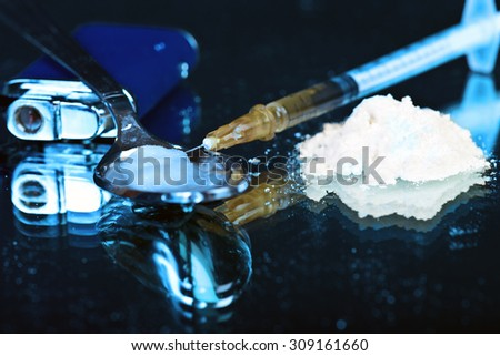 White powder on mirror with lighter spoon and syringe - stock photo